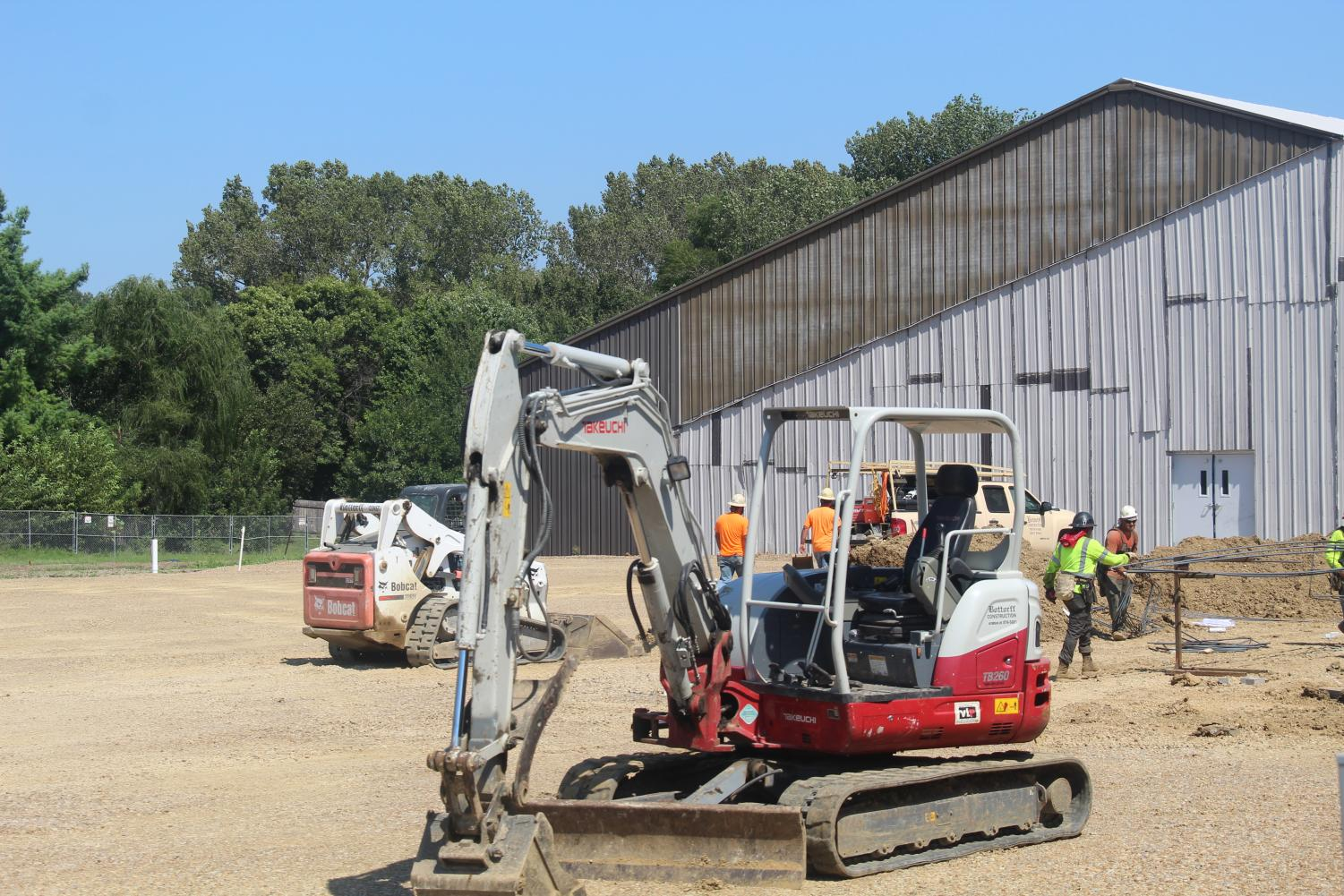 Construction+on+the+school+is+going+swimmingly.+Many+pieces+of+equipment+are+at+the+school.