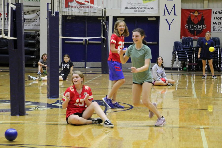 Left to Right: Seventh graders Hazel Powers, Makena Grant and Adelle Spiess play dodgeball during gym class. The dodgeball gym unit lasted for two weeks.