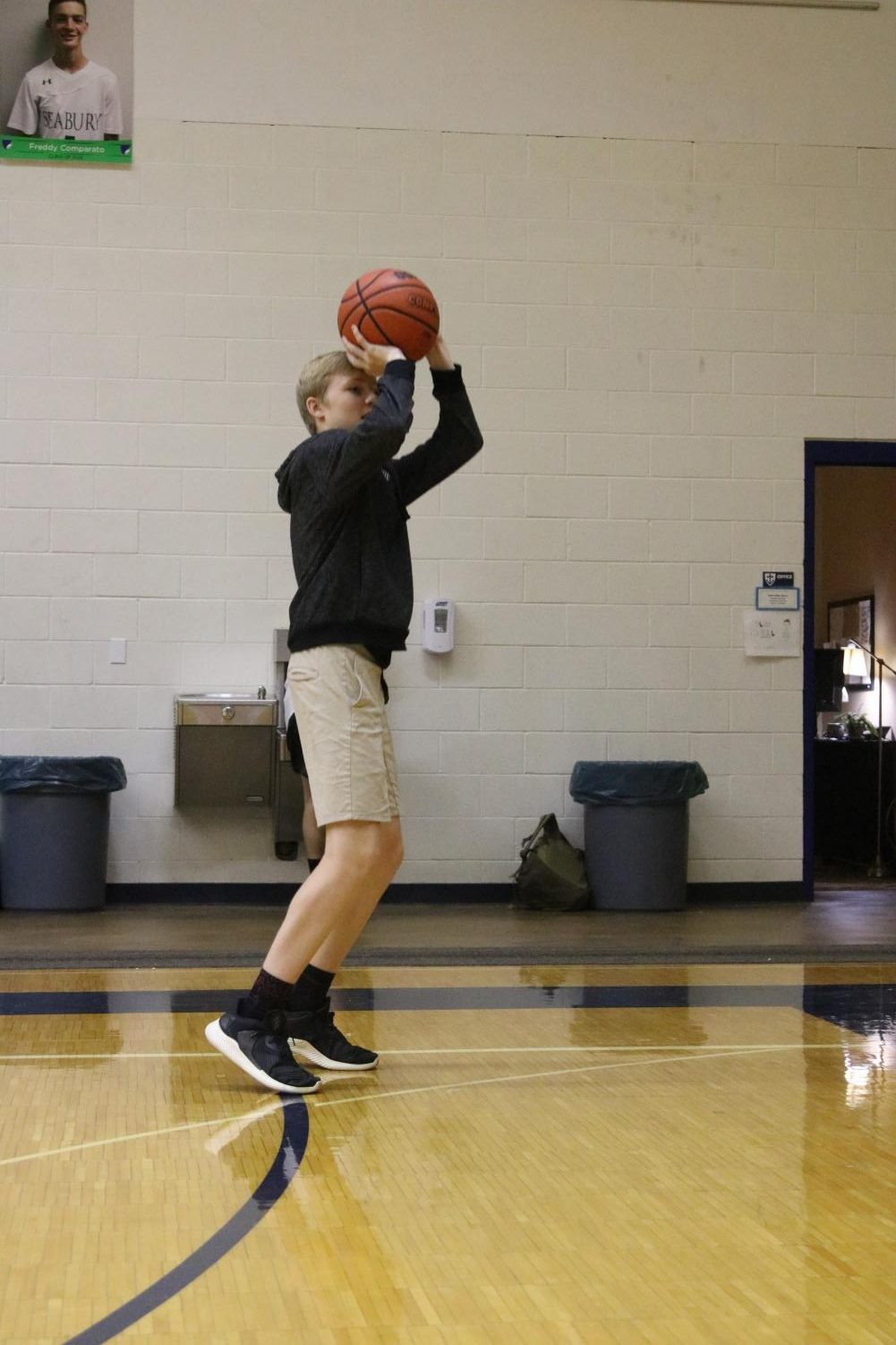 Freshman Shamus Sawyer prepares to shoot a basketball. Along with his love for all sports, he said he also has an interest in cars.