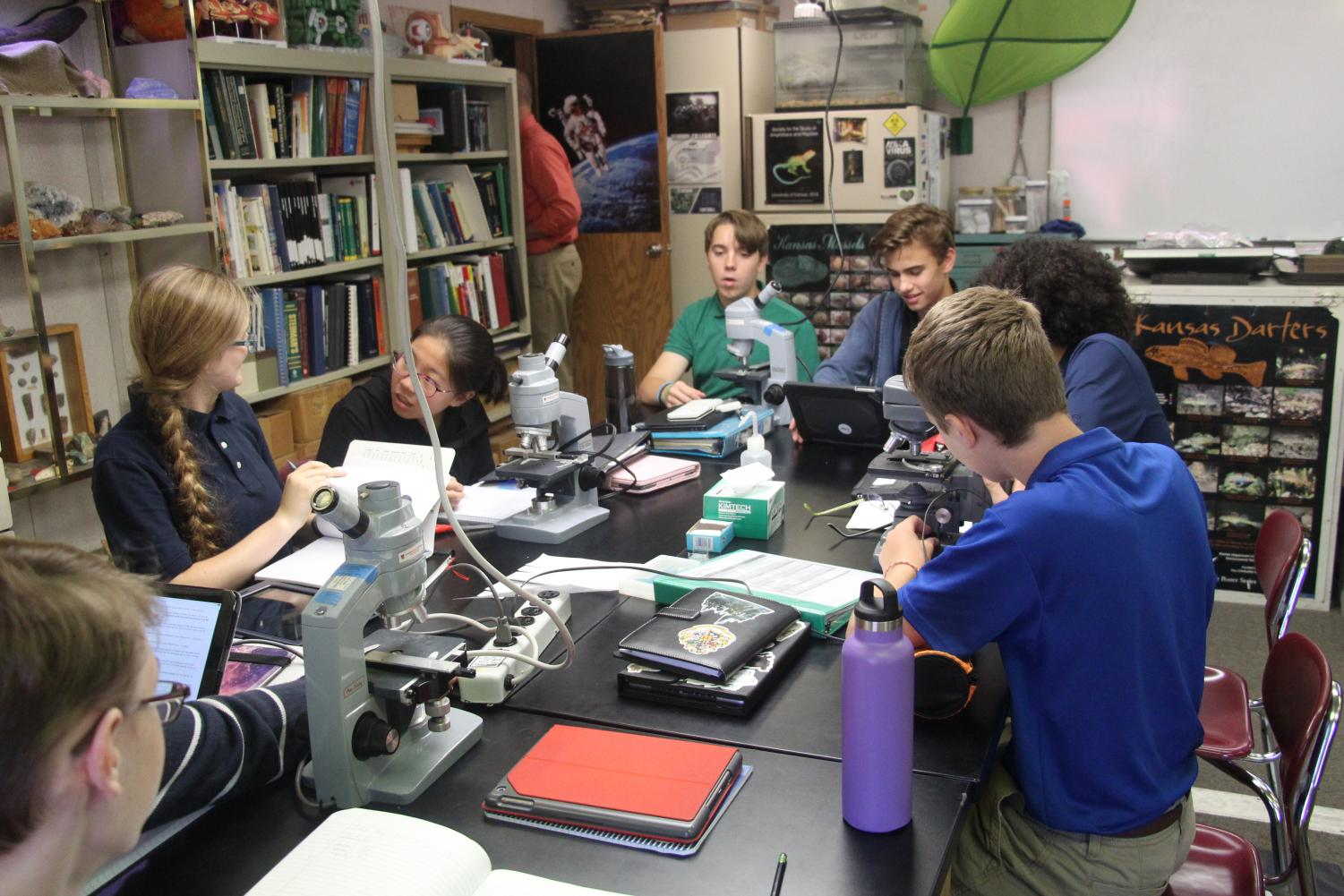 Left+to+Right%3A+Freshman+Valene+McInerney%2C+Celia+Liu%2C+Owen+Ross+and+Lear+Eicher+study+under+microscopes.+They+were+studying+water+samples+from+the+pond.
