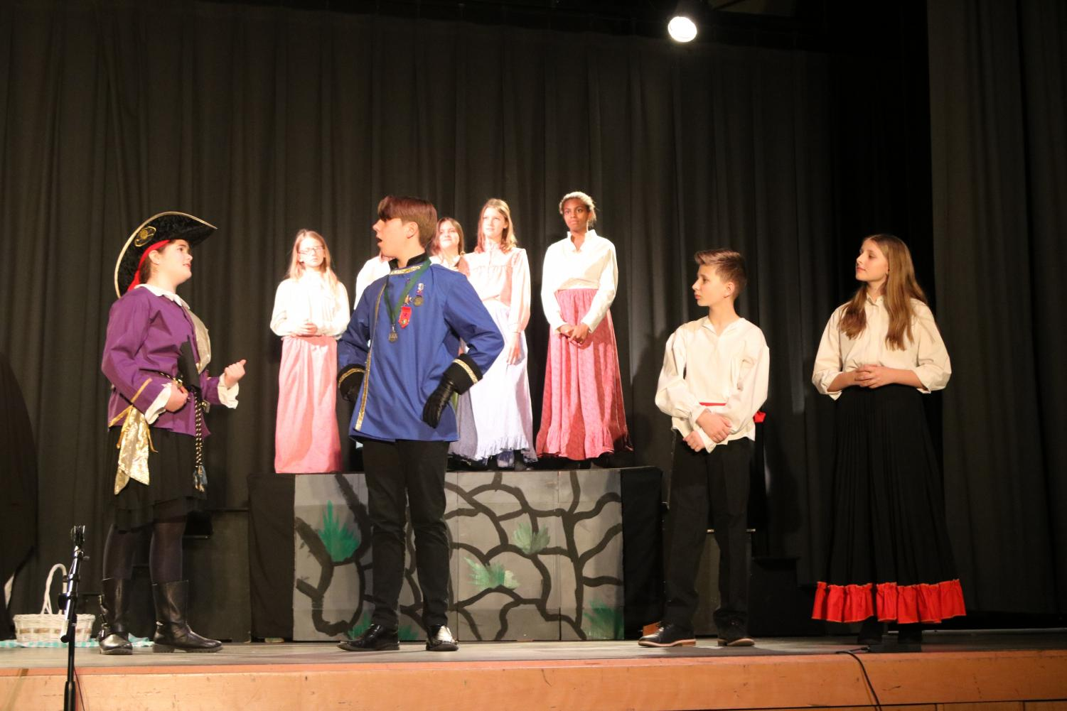 The+middle+school+actors+perform+the+play+%22Pirates%22.+James+Larocca+participated+in+the+announcements+for+the+play%2C+which+hyped+up+the+play.