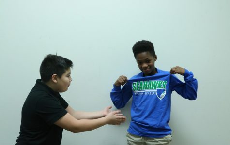 Sixth graders Milton Okazaki Lopez and Kavon Price argue about dress code. The dress code has been changed multiple years in a row.