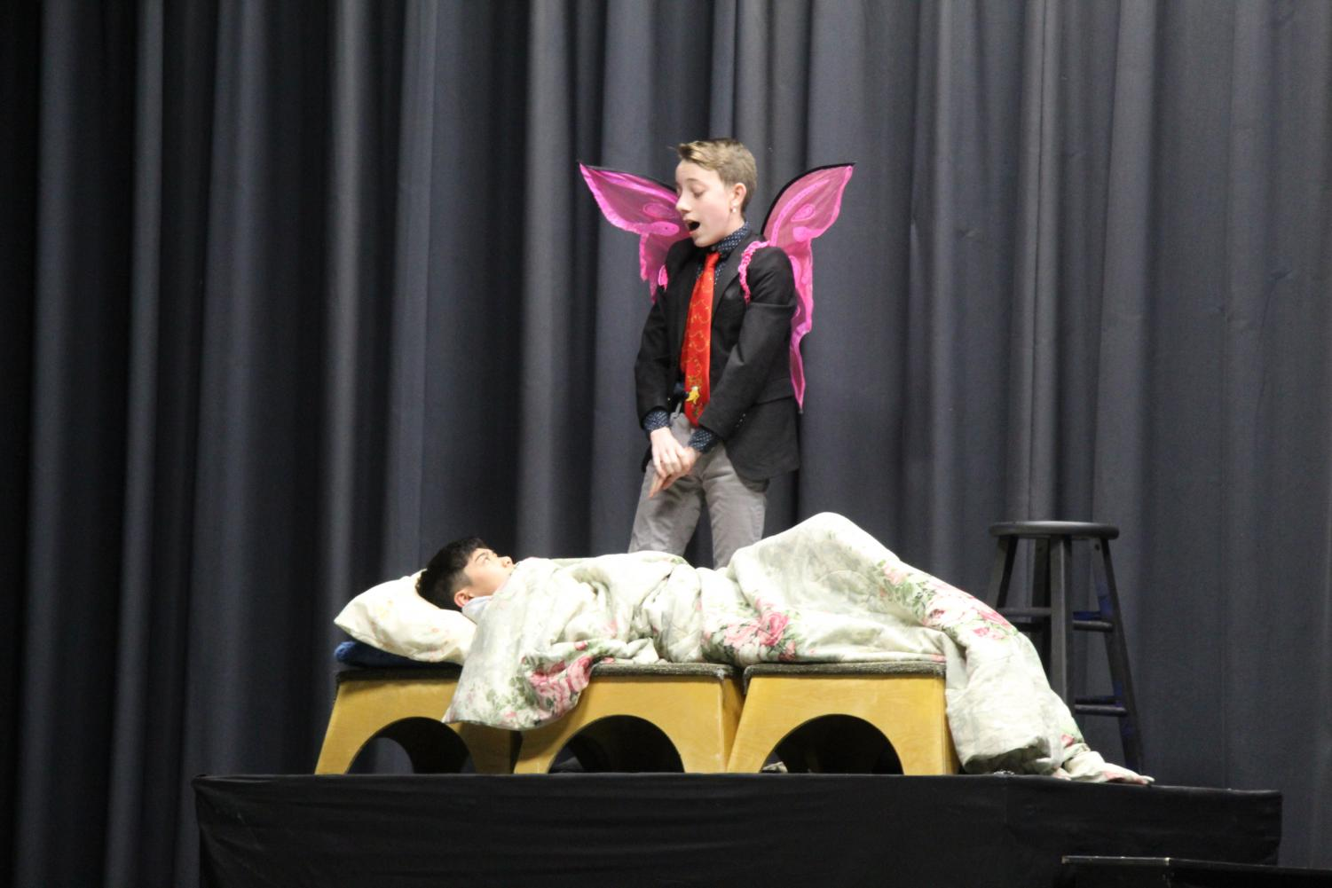 Freshmen Ivan Calderon stands over classmate Ethan Tangpornsin during the ninth grade play. Every year, the freshman drama class performs a play for the whole school