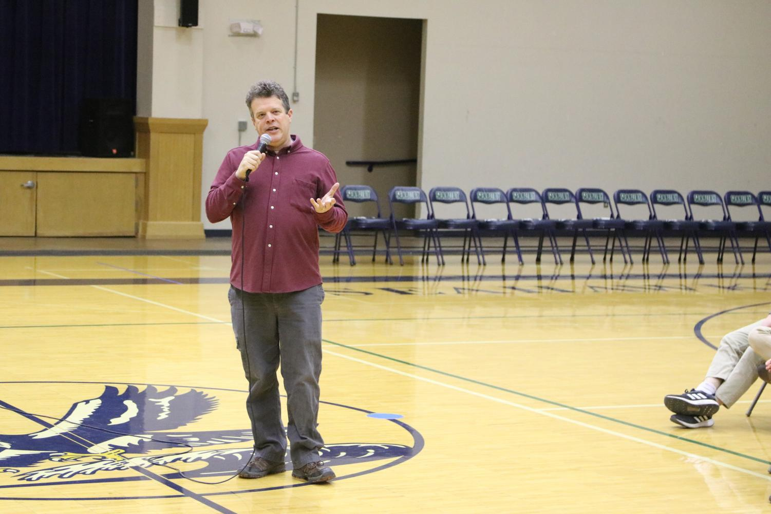 Father Rob Baldwin tells a story during chapel. Baldwin returned to Seabury after his three year absence this year.