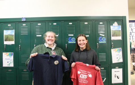 Senior Emma Silvestri and eighth grader Ellie Berkland hold shirts from their old schools. Similar to Seabury, Silvestri had to wear a uniform to school every day.