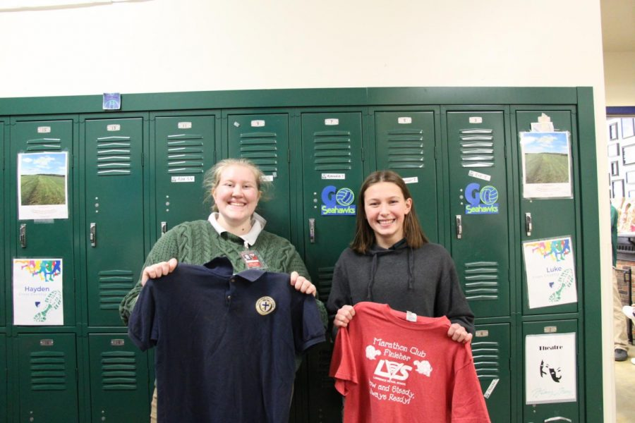 Senior+Emma+Silvestri+and+eighth+grader+Ellie+Berkland+hold+shirts+from+their+old+schools.+Similar+to+Seabury%2C+Silvestri+had+to+wear+a+uniform+to+school+every+day.+