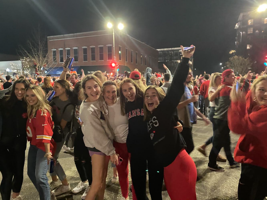 Freshman+Gisele+French%2C+former+student+Sophia+Ostlund%2C+and+sophomores+Maisy+Rader+and+Shea+Hanna+pose+during+the+chiefs+parade+in+downtown+Lawrence.+