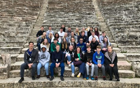 Participants of the Greece trip smile for a photo at the Great Theatre of Epidaurus. The students found a cat in the theatre who turned out to be particularly friendly and made an appearance in the group photo above