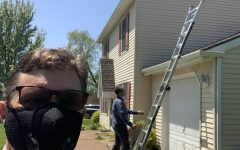 Bryan Hedges takes a selfie with a house inspector. Hedges' real estate business has adapted quickly to the COVID-19 pandemic.