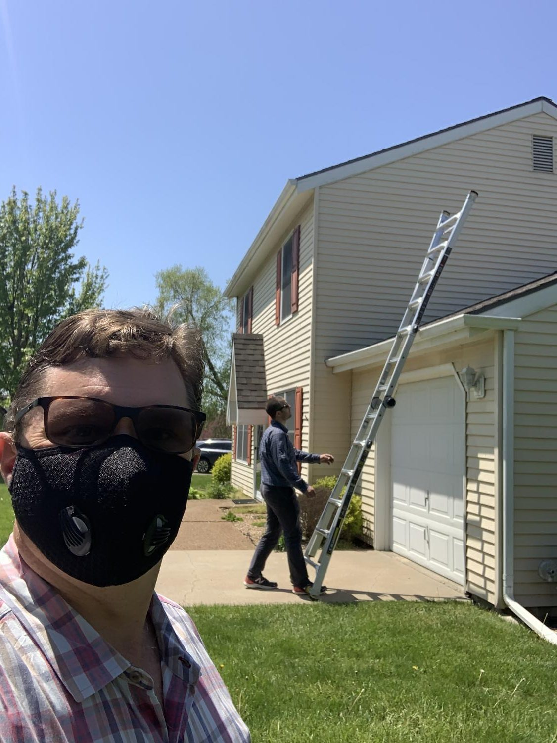 Bryan Hedges takes a selfie with a house inspector. Hedges