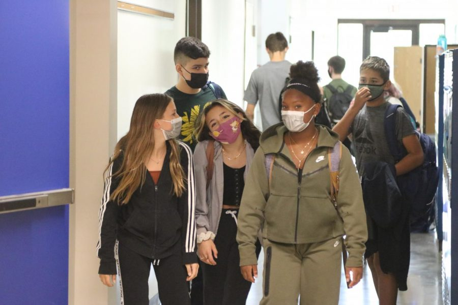 Seventh graders Isabella Gonzalez, Hannah Billen, KaNeisha Price (front), Lucas Sherwood and eighth grader Xavier Carrasco Cooper (back) show off the new dress code while walking to their next class. Students have enjoyed the opportunity to wear comfier clothes.